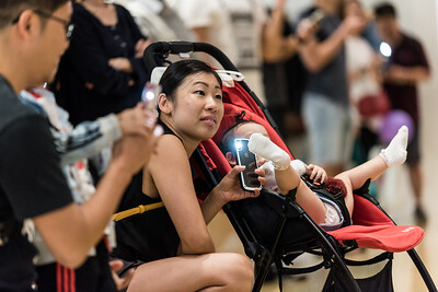 A mother with her baby join hundreds of local residents gather inside the CityPlaza Mall in Taikoo Shing, Hong Kong to sing and hold hands in solidarity. Families with kids, seniors with flip phones, and passionate youth gathered peacefully in protest against what they view as an authoritarian government and an unaccountable police force. November 3, 2019.
