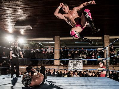 """""""The Playboy"""" John Atlas performs a flying attack on Evil Uno at Greektown Wrestling in Toronto. March 18, 2018."""