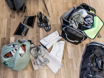 A wrestler's gear is splayed out on the floor in the makeshift dressing room in a church basement at Greektown Wrestling in Toronto. March 18, 2018.