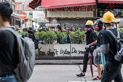 Protesters march past graffiti on Nathan Road in Hong Kong. This message in particular represents the frustration felt by the people due to government inaction on a set of human rights and democracy requests. October 20, 2019.