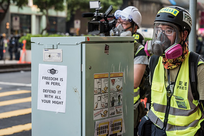 Membesrs of the press follow a trail of riot police, documenting one of many protests in the streets of Hong Kong. October 20, 2019.