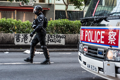 A member of the Hong Kong police force marches down Nathan Road, Hong Kong. October 20, 2019.