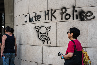 Residents walk past a newly placed piece of graffiti in Kowloon, Hong Kong. Nearby, thousands of residents had gathered in a large anti-government protest. October 20, 2019.