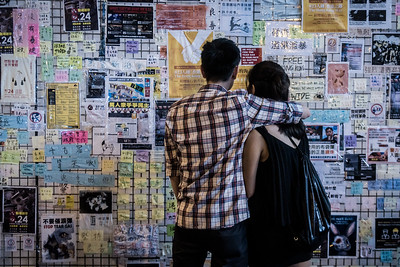 A couple looks over a Lennon Wall in the Kornhill neighbourhood of Hong Kong. Dozens of these walls dot the city and feature anti-government posters, words of encouragement for protesters, and notices for upcoming rallies. August 23, 2019.