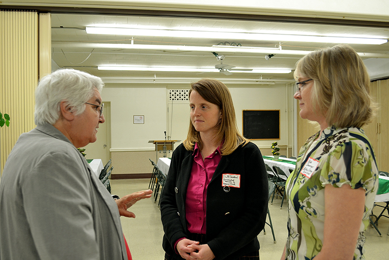 Precious Blood Sister Mary Yarger, left, talks with Consecrated Woman of Regnum Christi Jill Swallow and Beth Dammeyer of the St. Mary's/Sidney Deaneries Serra Club.