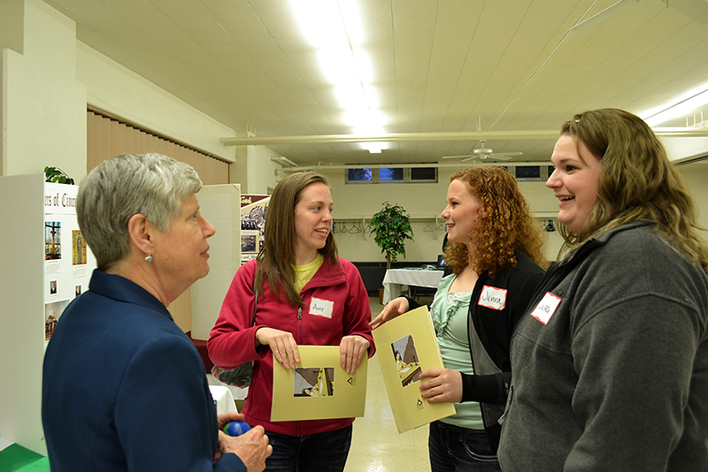From left, Oldenburg Franciscan Sister Joan Miller speaks with Amy Pequignot, Jenna Rindler and Laura Anderson about life as a Sister at a Martha Dinner on April 8 at St. Denis Parish in Versailles.