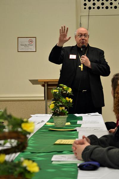 Cincinnati Auxiliary Bishop Joseph R. Binzer speaks during a Martha Dinner on April 8 at St. Denis Parish in Versailles.