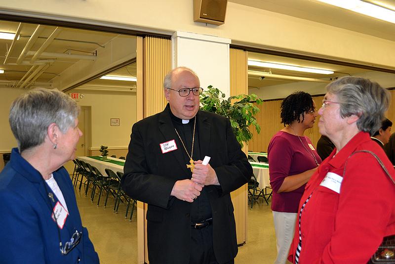 Cincinnati Auxiliary Bishop Joseph R. Binzer talks with Oldenburg Franciscan Sister Joan Miller, left,  and Precious Blood Sister Martha Bertke.