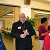 Cincinnati Auxiliary Bishop Joseph R. Binzer talks with Oldenburg Franciscan Sister Joan Miller, left,  and Precious Blood Sister Martha Bertke.