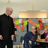 Father Kyle Schnippel talks with Kelsey Eck during a discussion about vocations at Mother Teresa Catholic Elmentary School.