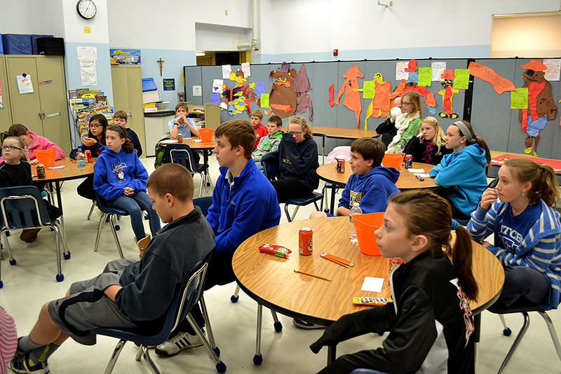 Students at Mother Teresa Catholic Elementary School in Liberty Township, Ohio, listen to a presentation on vocations.