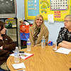 Precious Blood Sister Anne Schulz, right, speaks with teachers Amanda Ocariz, left, and Lisa Hollstegge during a discussion on vocations at the school.
