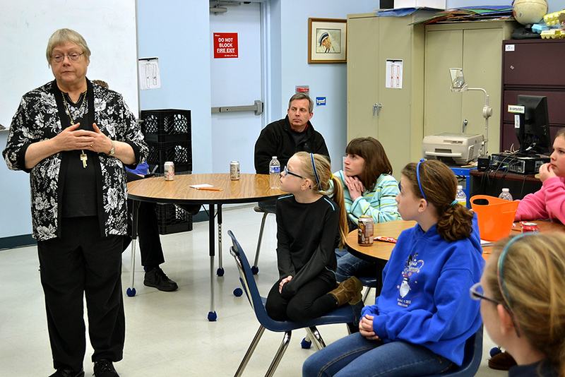Precious Blood Sister Anne Schulz speaks about vocations at Mother Teresa Catholic Elementary School. Looking on from left are student Carmen Eck, Rachael Roth, Makenzie Mulcare, and Grace Carmosino.