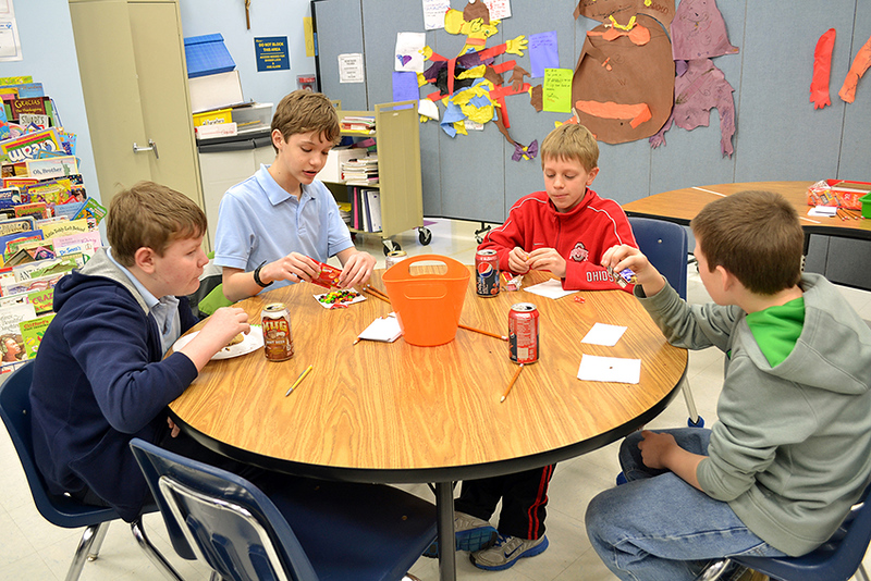 Students at Mother Teresa School discuss vocations to religous life. From left, Max Hall, Connor Japikse, Luke Meyer and John Sikora.