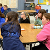 Students at Mother Teresa Catholic Elementary School listen during a presentation on vocations. Background  from left, Alli O'Connor, Grant Manwaring and Ethan Meyer. Foreground from left, Grace Carmosino, Carmen Eck, Rachael Roth, Mackenzie Mulcare, and Thu Gibson.