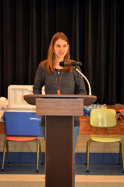 Heather Borchers of St. Remy Parish in Russia, Ohio, speaks about Serra Club of St. Mary's/Sidney deaneries at the 'Stepping up the Call' Nov. 17 at St. Charles Center in Carthagena.