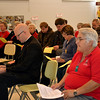 Father Kyle Schnippel, vocations director for the Archdiocese of Cincinnati, and Precious Blood Sister Mary Yarger, congregational vocations coordinator, listen to a speaker during the 'Stepping up the Call' event Nov. 17 at St. Charles Center in Carthagena.
