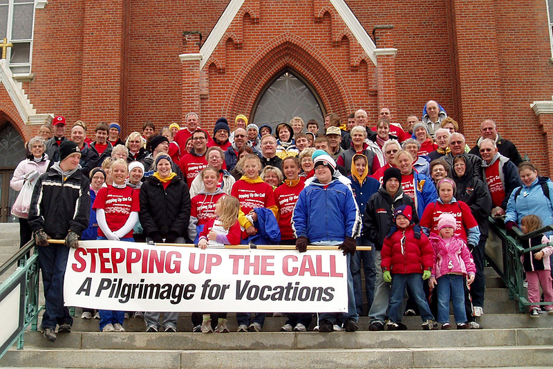 Eager pilgrims pose for a photo on the steps of St. Augustine's Church in Minster, Ohio. They began with morning prayer before taking to the roadways. The annual pilgrimage took walkers (and riders) to up to eight churches and holy sites, where they prayed, heard witness talks on different kinds of church vocations, and enjoyed snacks and lunch. Photo by Sister Noreen Jutte, C.PP.S.