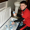 Jacob Kitzmiller from Ft. Loramie, Ohio, helping to distribute water to the pilgrims. Photo by Sister Carolyn Hoying, CPPS