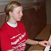 Bethany Wilker, a freshman at Marion Local School. She filled in for her mother Doris who was called in to work at the hospital the day of the Pilgrimage. Bethany did a very fine job of leading us with the music. Photo by Sister Regina Albers, CPPS