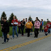 Pilgrims of all ages pray and sing as they walk the roadways. Photo by Sister Carolyn Hoying, CPPS