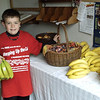 """Get your bananas here!"" Young Owen Kitzmiller of Fort Loramie helped set up and distribute snacks for the pilgrims at St. Joseph Church in Egypt. Healthy snacks, including granola bars, water, and more than 55 lbs. of bananas fed hungry pilgrims at the various stops. Photo by Sister Carolyn Hoying, CPPS"