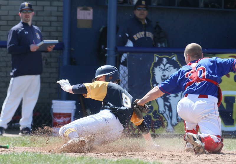 PH N #8 Brett Manis slides into home vs Cousino catcher Michael Rice  - Port Huron Northern hosted Cousino for Baseball. April 8th, 2017 (MIPrepzone photo gallery by David Angell)