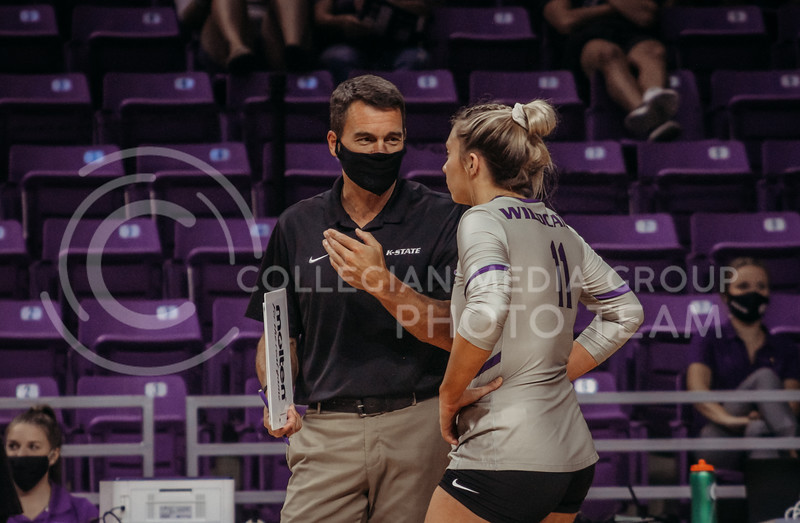 Shelby Martin consults with a coach between sets during the Kansas State volleyball game against Iowa State at Bramlage Coliseum on Sept. 26, 2020. (Sophie Osborn | Collegian Media Group)