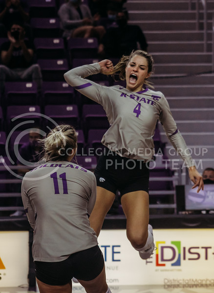 Kadye Ferholz celebrates in the air after an intense point win during the Kansas State volleyball game against Iowa State at Bramlage Coliseum on Sept. 26, 2020. (Sophie Osborn | Collegian Media Group)