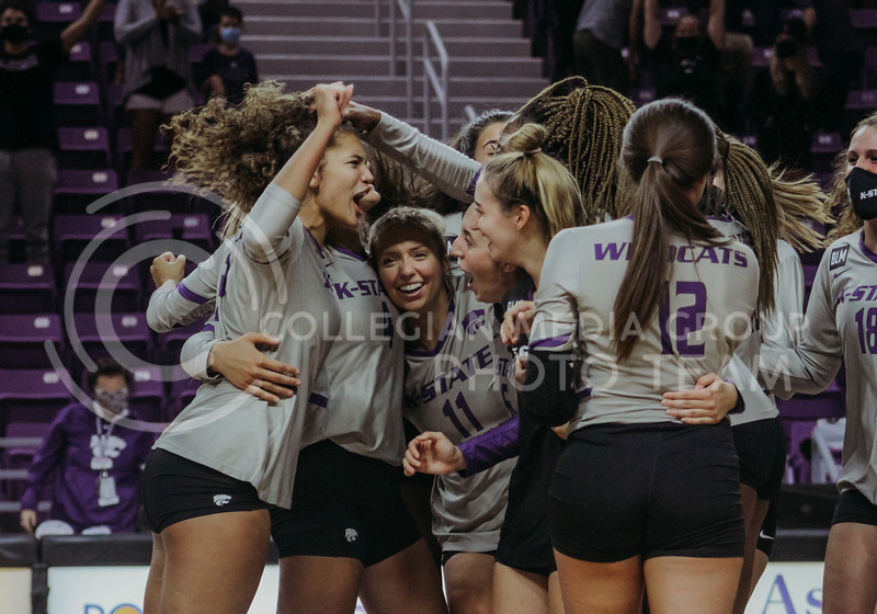 The team celebrates after winning the final set after losing to Iowa State the previous night. (Sophie Osborn | Collegian Media Group)