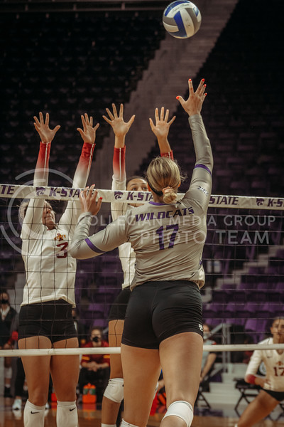 Brynn Carlson spikes the ball while Iowa State players prepare to block during the Kansas State volleyball game against Iowa State at Bramlage Coliseum on Sept. 26, 2020. (Sophie Osborn | Collegian Media Group)