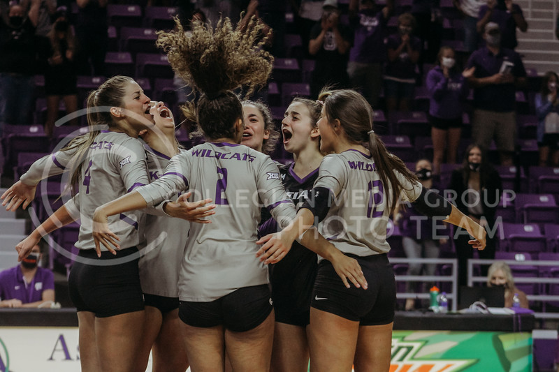 The team celebrates after scoring a final point against Iowa State to win the game during the Kansas State volleyball game against Iowa State at Bramlage Coliseum on Sept. 26, 2020. (Sophie Osborn | Collegian Media Group)