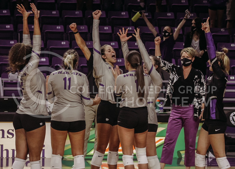 The Kansas State Volleyball team celebrates after getting word that the final point of the game was fair after Iowa State challenged the call during the game against Iowa State at Bramlage Coliseum on Sept. 26, 2020. (Sophie Osborn | Collegian Media Group)