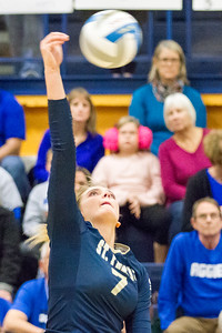 Record-Eagle/Brett A. Sommers Traverse City St. Francis' Molly Mirabelli sends and attack toward the net during Tuesday's Division 3 quarterfinal volleyball match against Beal City at Cadillac High School. St. Francis won 3-1.