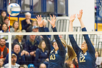 Record-Eagle/Brett A. Sommers Traverse City St. Francis' Hannah Sidorowicz (10) and Brenna Poole (12) attempt to block a Beal City attack during Tuesday's Division 3 quarterfinal volleyball match at Cadillac High School. St. Francis won 3-1.