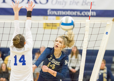 Record-Eagle/Brett A. Sommers Traverse City St. Francis' Kaylin Poole (14) converts a kill during Tuesday's Division 3 quarterfinal volleyball match against Beal City at Cadillac High School. St. Francis won 3-1.