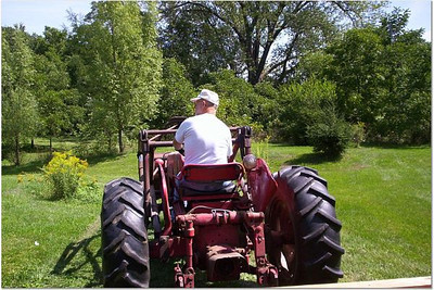2005-8-26 00010 Back of Mr. M Back view of Mr. M pulling us on the tractor
