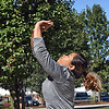 Trying her hand at volleyball in Clemente Park is Noeum Chhim, mother of one of the kids in the free program. SUN/David H. Brow