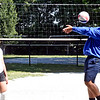 At a free volleyball clinic at Clemente Park is Trisha Chea 13, as she keeps an eye on Curtis Chanthaboun 14, working the ball. SUN/David H. Brow