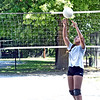 Setting a ball up for a spike is Akyli Phen 13, at a free volleyball clinic at Celmente Park in Lowell. SUN/David H. Brow