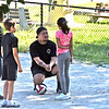 Clemente Park free volleyball clinic volunteer instructor Vannak Kong of Lowell giving helping tips to Nadiyah Lam 11, and others L-R, Nathan Villa 11, Cash Wilder 8, and Tila Khat-Tek 13. SUN/David H. Brow