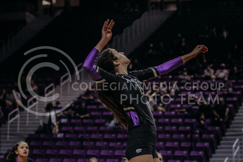 Sophomore Holly Bonde looks to hit the oncoming ball during the March 20, 2021 Senior Night game against Creighton at Bramlage Stadium. (Sophie Osborn   Collegian Media Group)