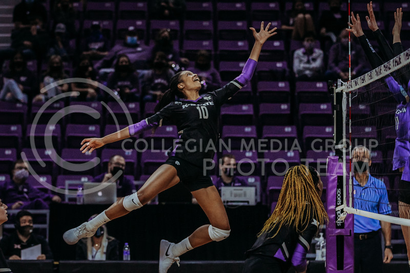 Freshman outside hitter Jayden Nembhard stretches out to tap a ball over the net during the March 20, 2021 Senior Night game against Creighton at Bramlage Stadium. (Sophie Osborn   Collegian Media Group)
