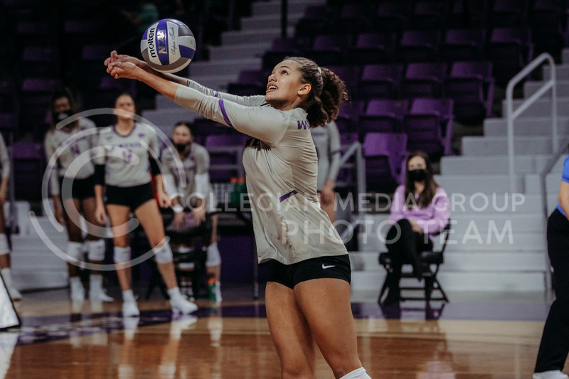 Freshman Aliyah Carter hits the ball up during the March 14, 2021 volleyball game against Saint Louis University. (Sophie Osborn   Collegian Media Group)