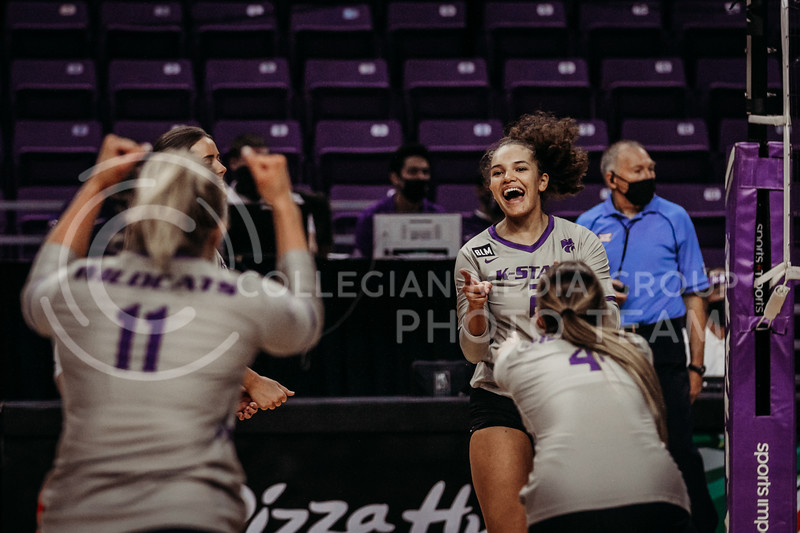 The team celebrates a win during the March 14, 2021 volleyball game against Saint Louis University. (Sophie Osborn   Collegian Media Group)