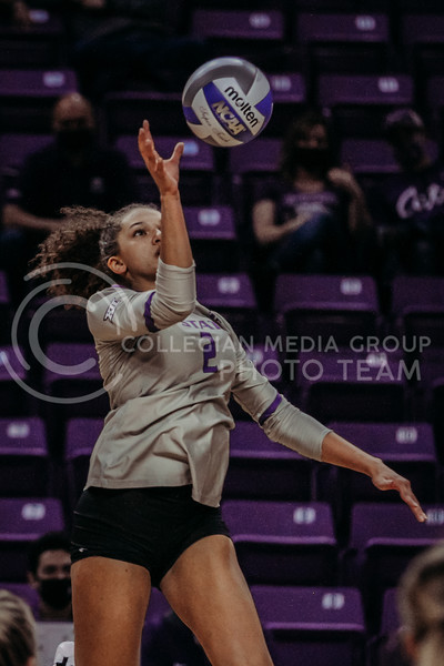 Freshman Aliyah Carter prepares to push the ball over the net during the March 14, 2021 volleyball game against Saint Louis University. (Sophie Osborn   Collegian Media Group)