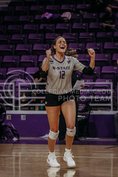 Sophomore Loren Hinkle celebrates a teammates success during the March 14, 2021 volleyball game against Saint Louis University. (Sophie Osborn   Collegian Media Group)