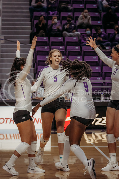 The team celebrate a successful point during the game against Texas Christian University on Nov. 13, 2020. (Sophie Osborn | Collegian Media Group)