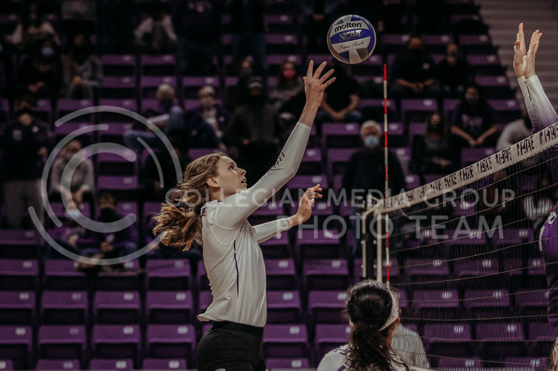 Sophomore middle blocker Kayley Hollywood prepares to attempt to get the ball past the readying defense during the game against Texas Christian University on Nov. 13, 2020. (Sophie Osborn | Collegian Media Group)