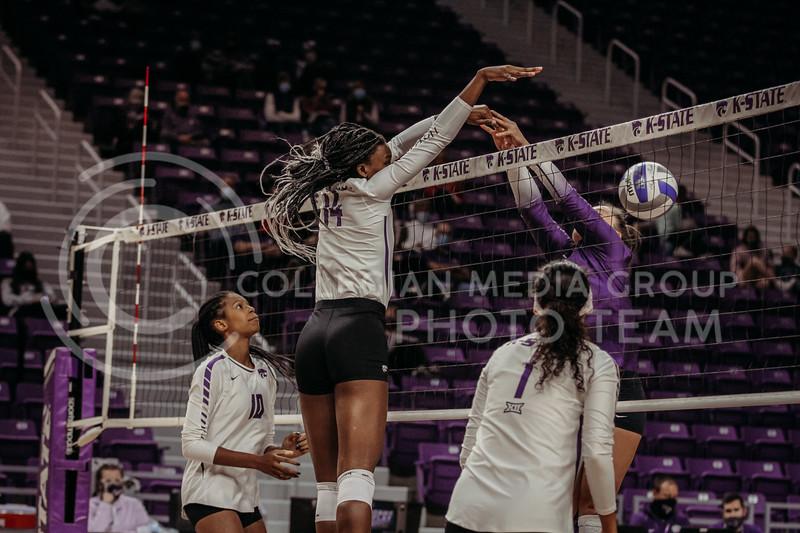 Junior middle blocker Megan Vernon successfully returns the ball past the opponent during the game against Texas Christian University on Nov. 13, 2020. (Sophie Osborn | Collegian Media Group)